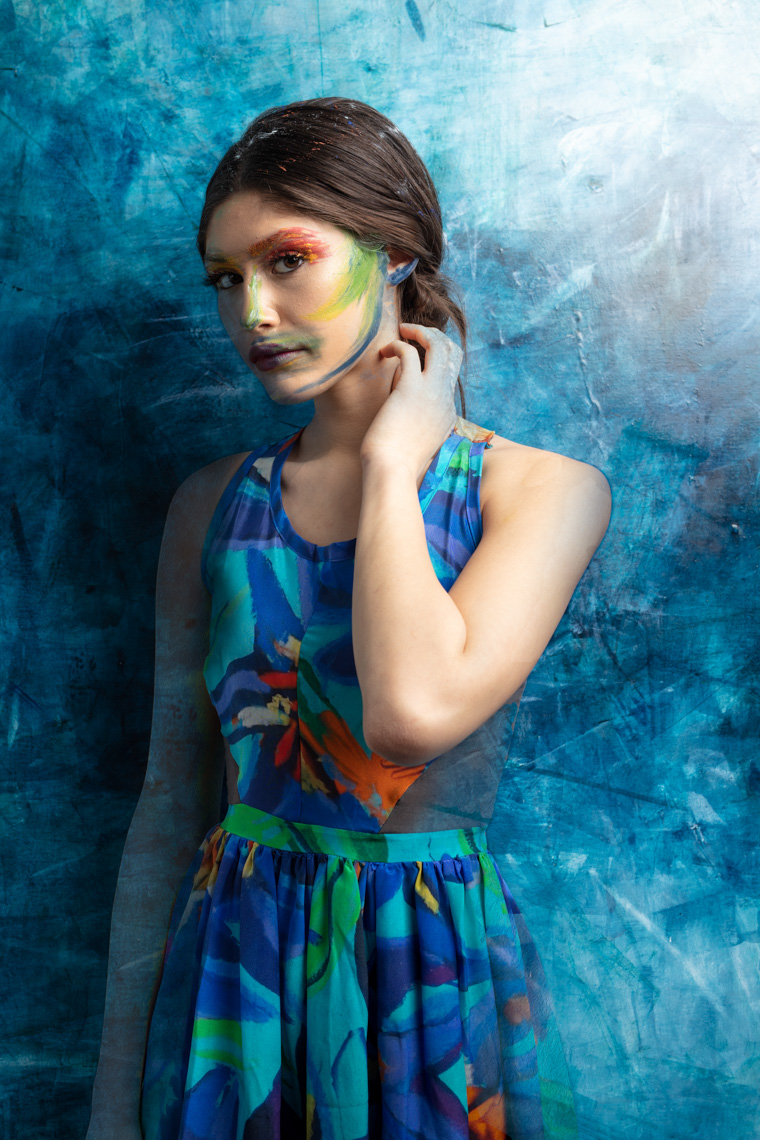 conceptual-image-fashion-model-emerging-from-abstract-painting