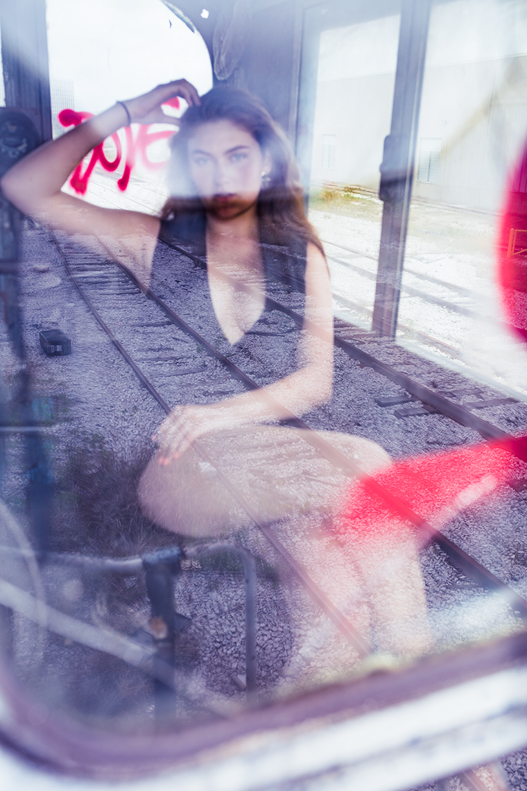 fashion-editorial-model-in-cab-abandoned-train-engine