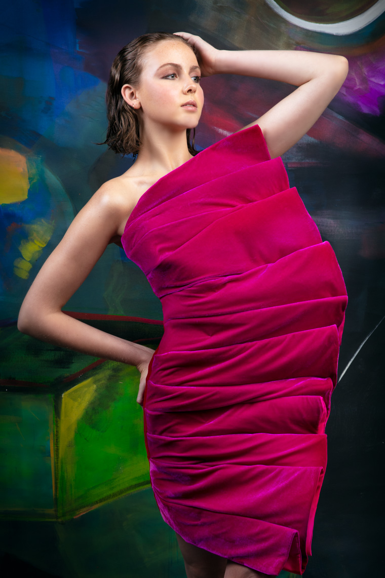 model-in-couture-sheath-dress-abstract-art-background